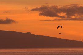 Paragliding on sunset