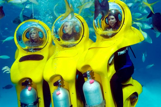 Bob diving with 3 girls